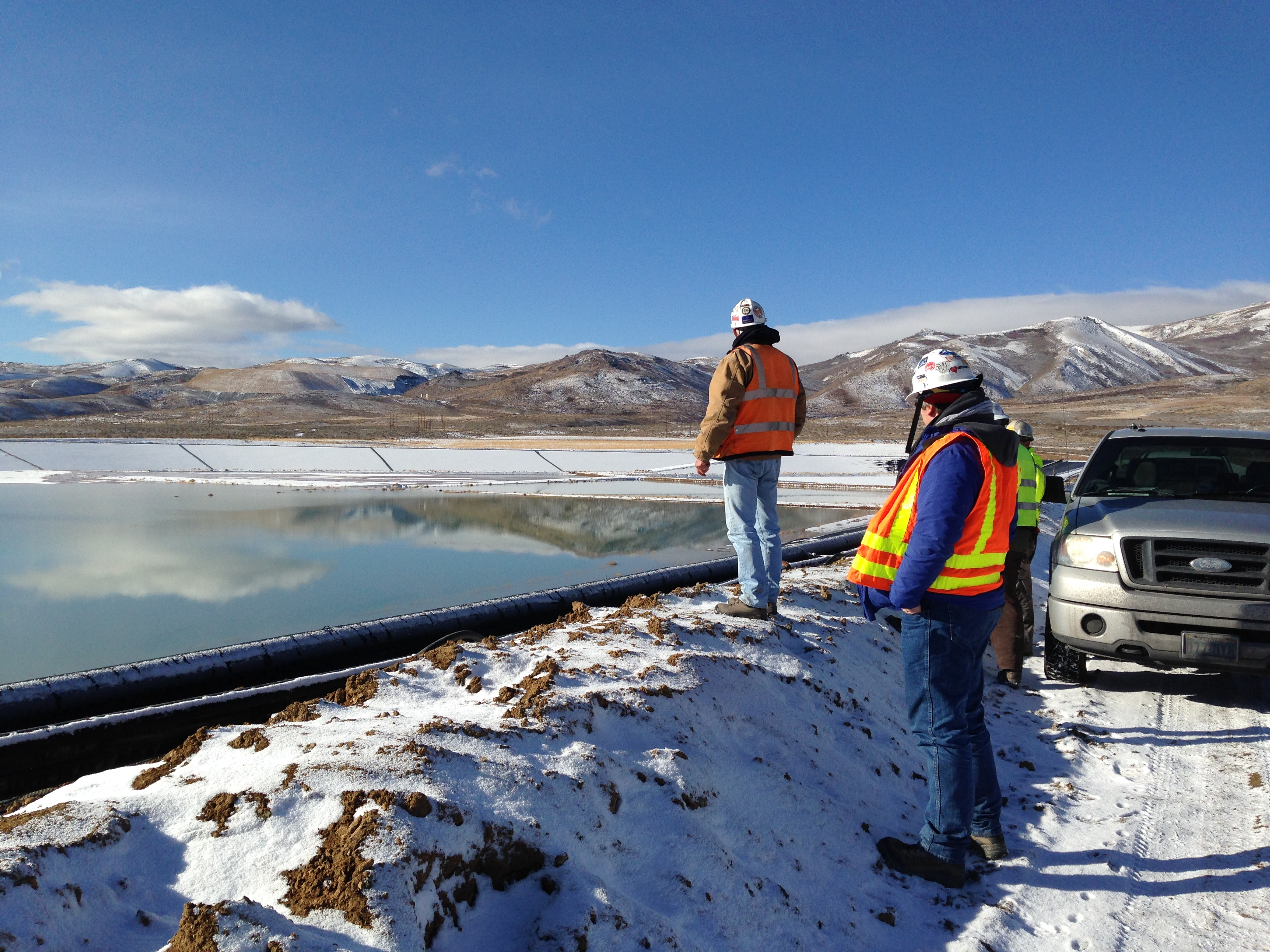 BMRR employees inspecting a tailings impoundment.