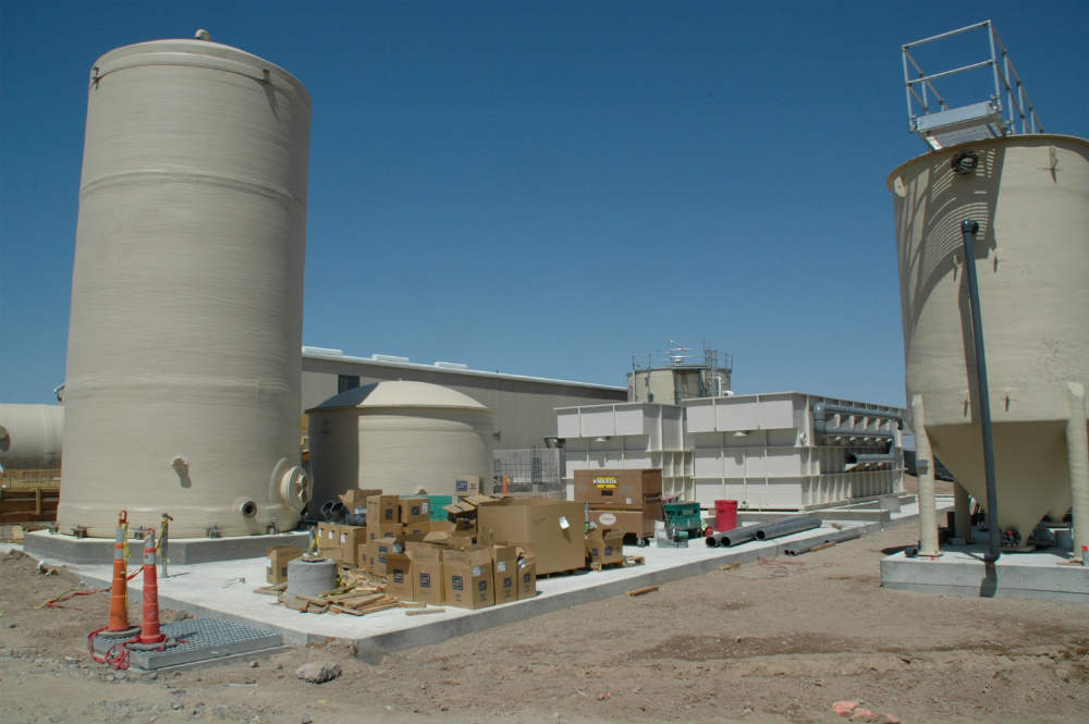 Construction of Endeavour's current groundwater treatment system, which began operating in 2012.  From left to right: sludge storage tank, clarified water tank, two dissolved air flotation tanks (DAFs), and one sand filter.  An influent equalization tank is located behind the DAFs.