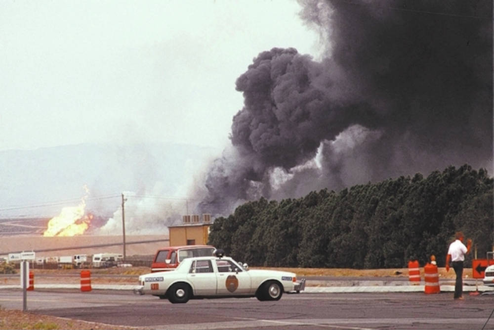 Smoke rising from the former PEPCON plant site after a series of fires and explosions at the facility on May 4, 1988.