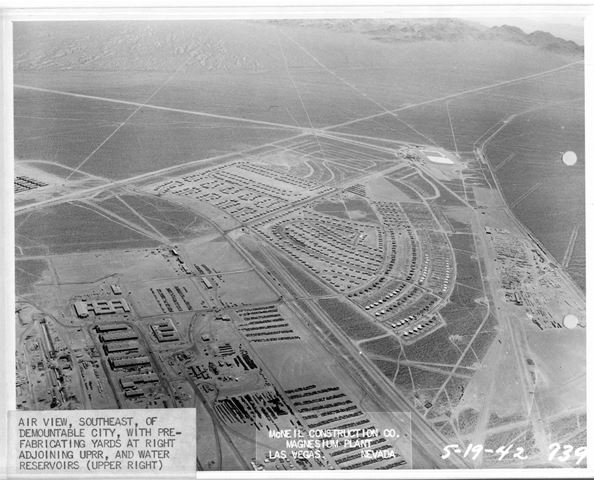 5/19/1942 - Air view, southeast, of demountable city, with prefabricating yards at right adjoining UPRR, and water reservoirs (upper right)