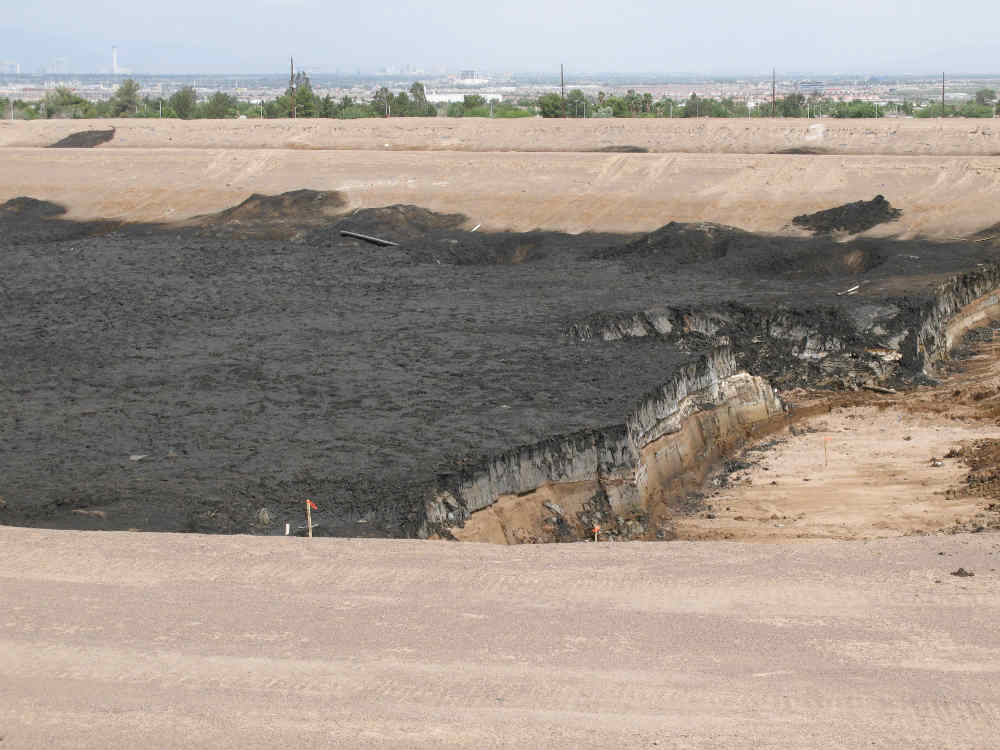 2007 - Layering of disposal pond and underlying soil exposed during excavation activities to remediate a typical evaporation pond.