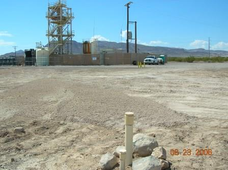 2006-08-23 Groundwater Treatment System.  Monitoring well in foreground, treatment system in background.