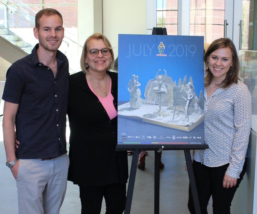 From left: John-Henry, Debbie, and Rachel Lambin with 2019 Artown poster